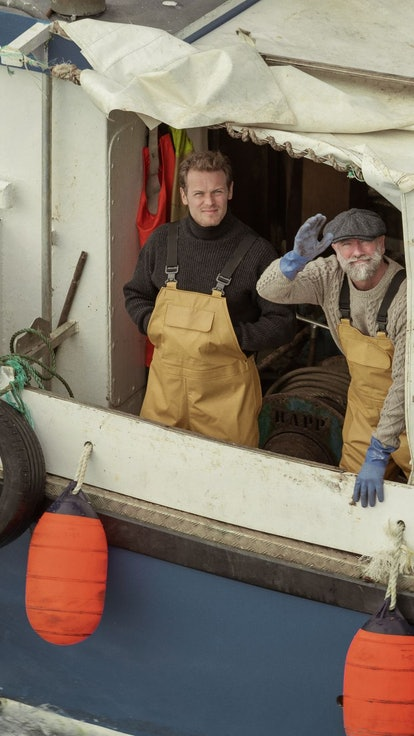 Watch Sam Heughan & Graham McTavish Try Their Hand At Fishing In This 'Men In Kilts' Clip